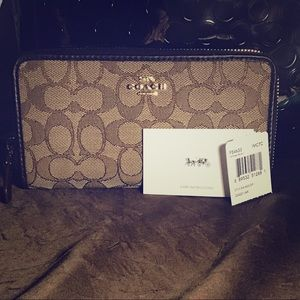 Brown and tan monogrammed zip coach wallet